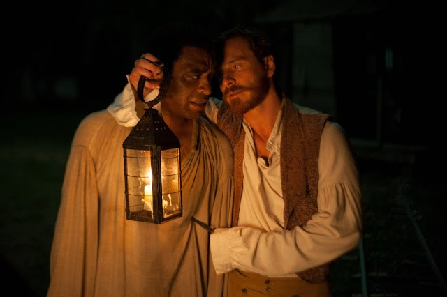 "12 Years A Slave still - Chiwetel Ejiofor as ""Solomon Northup"" and Michael Fassbender as ""Edwin Epps."""