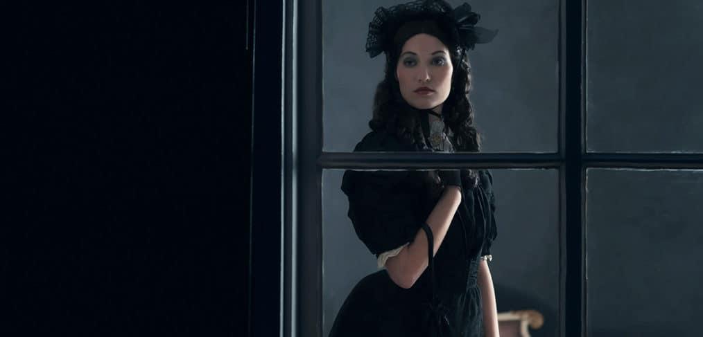 Woman in victorian era costume
