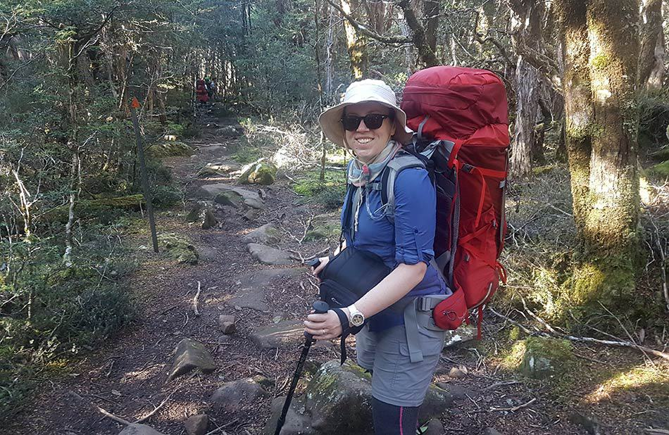 Woman carrying a heavy backpack on the Overland Track