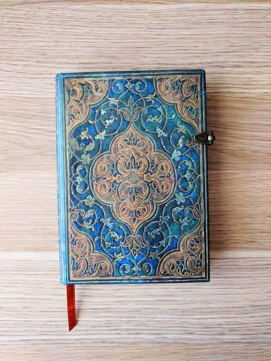 Journal with an ornate blue and gold cover